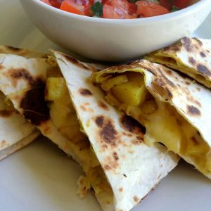 Cumin Spiced Potato Quesadillas. With a Tomato and Cucumber Salsa