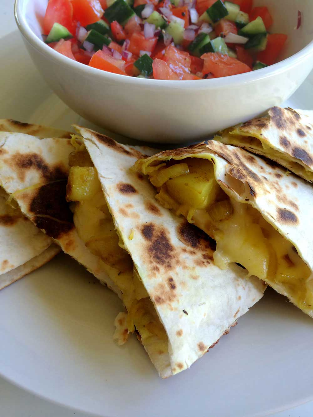 Cumin Spiced Potato Quesadillas. With a Tomato and Cucumber Salsa