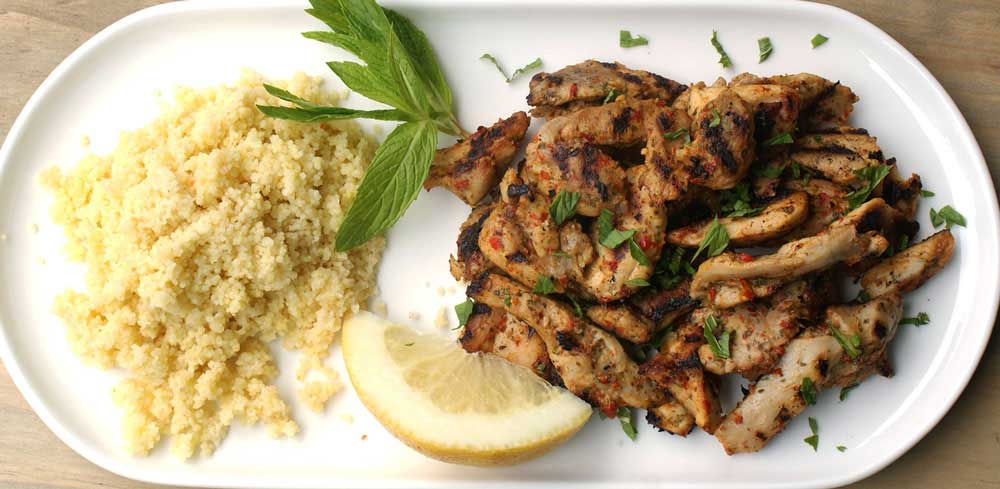 Chicken with Chilli, Mint and Lemon served with Buttered Couscous. A great chicken recipe. Chicken with chilli, mint and lemon all served with a fluffy buttery couscous. Perfect for cooking outdoors.