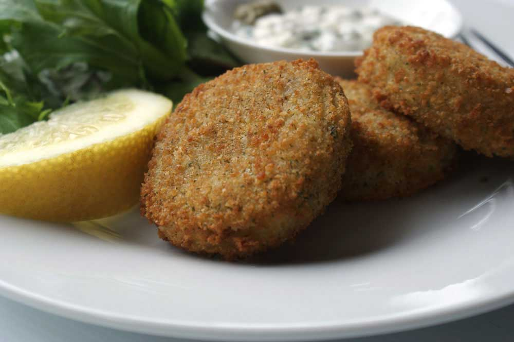 Cod Fish Cakes With A Caper Mayonnaise Sprinkles And Sprouts