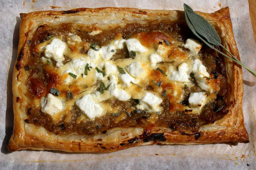 Feta and Sweet Onion Tart. A delicious onion tart with crumbled feta cheese. Perfect served with a salad and a ice cold glass of wine. Easy entertaining.