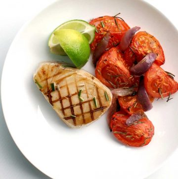 Seared Tuna with Roasted Rosemary Tomatoes - recipe. Rosemary, lime and garlic are used to marinate the fresh tuna, served with sweet roasted tomatoes