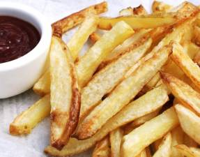 Crispy Oven Baked Fries. The potatoes are oven cooked in coconut oil, making them a healthy side dish.