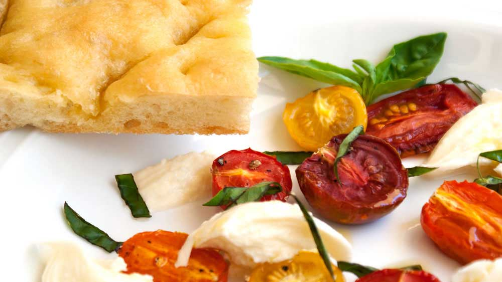 Roasted Tomatoes and Mozzarella Served with Garlic focaccia. A light and summery lunch.