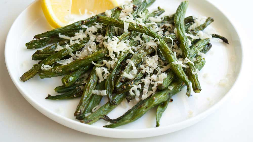 Roasted Green Beans with Parmesan and Rosemary. A great side dish, the beans are tender but crisp and the parmesan and rosemary marry amazingly together.