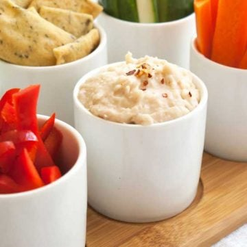 White Bean Dip. Store cupboard ingredients are used to create this delicious and easy bean dip. A vegan, gluten free, dairy free, sugar free, egg free and nut free appetiser.