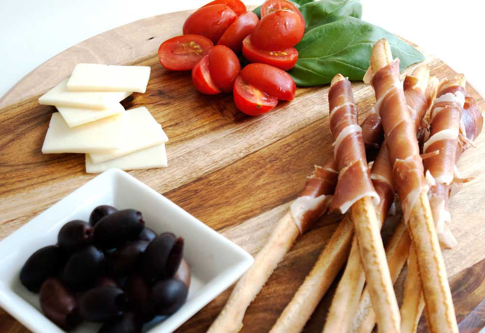 Homemade Grissini. Gnarly, crunchy breadsticks perfect for dipping. Wrap them in prosciutto for an elegant and easy entertaining idea.