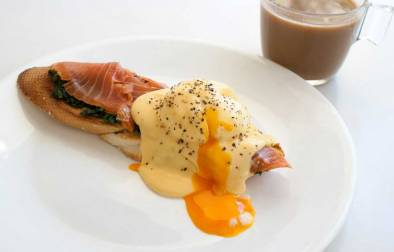 Eggs Atlantic with a Florentine Twist. A softly poached egg with smoked salmon and spinach drizzled in a buttery rich hollandaise sauce.
