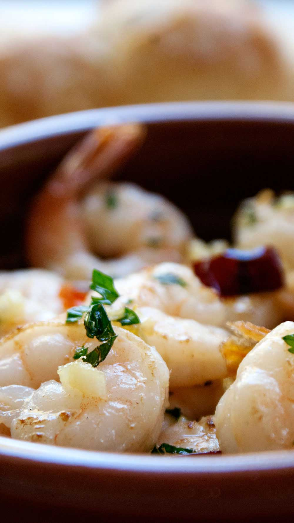 Gambas Pil Pil. A delicious dish of prawns (shrimps) in a wonderful garlic and chilli olive oil. Perfect tapas.