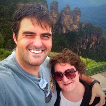 Claire McEwen and Stewart McEwen standing in front of the blue mountains