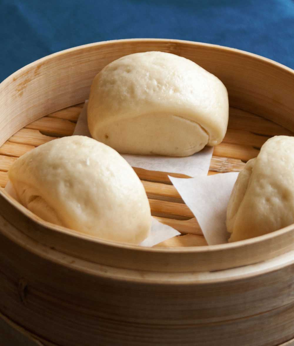 Mantou - Steamed Buns. These steamed soft and fluffy buns are perfect with noodle soups or any Chinese dish.