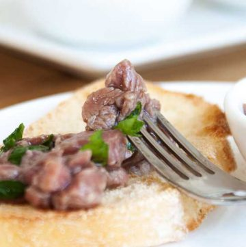 Italian Carne Cruda, a delicious and decadent starter. Beef fillet is lightly 'cooked' with lemon juice and served with crisp ciabatta.