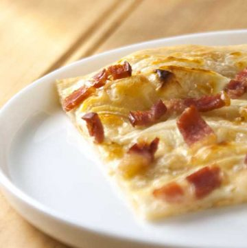 Flammekueche. Bacon and Onion Tart. A delicious French dish from Alsace.