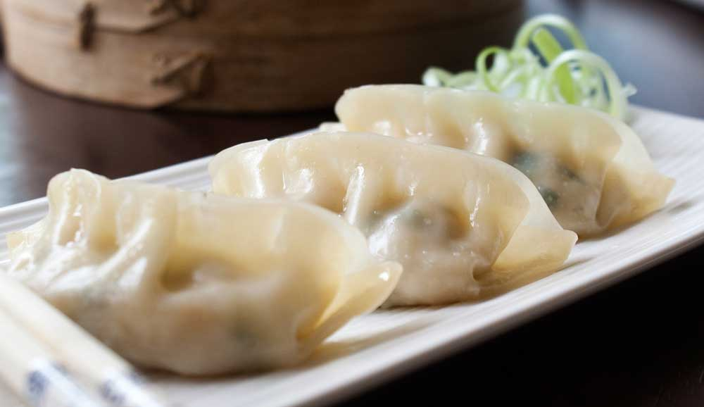 Steamed Prawn Gyoza (potstickers) are easier to make than you'd expect and they taste 100 times better than the store-bought ones!