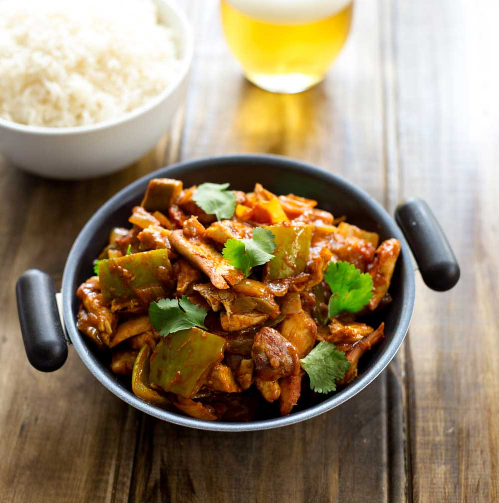Chicken Jalfrezia fresh, zesty spicy curry packed withfresh tomatoes, green peppers, green chillies, onions, herbs andspices. Crack open a beer and enjoy a homemade 'takeaway'.