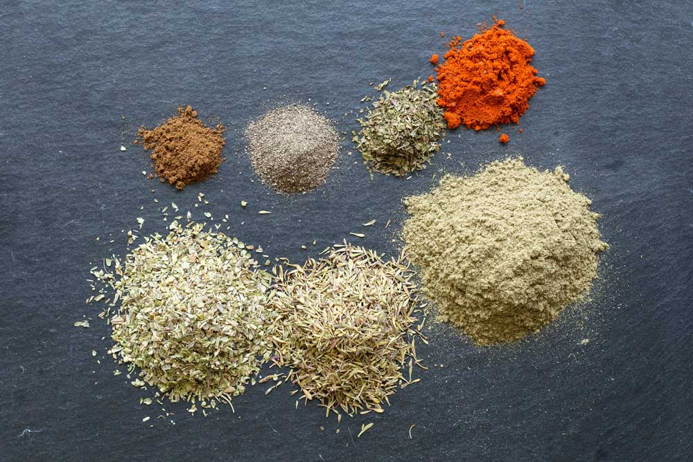Homemade chicken seasoning herb blend. It is an aromatic blend of herbs and spices that turns a plain roast chicken piece into a delicious rotisserie style chicken piece. Simple to make and you control the salt!| Sprinkles and Sprouts