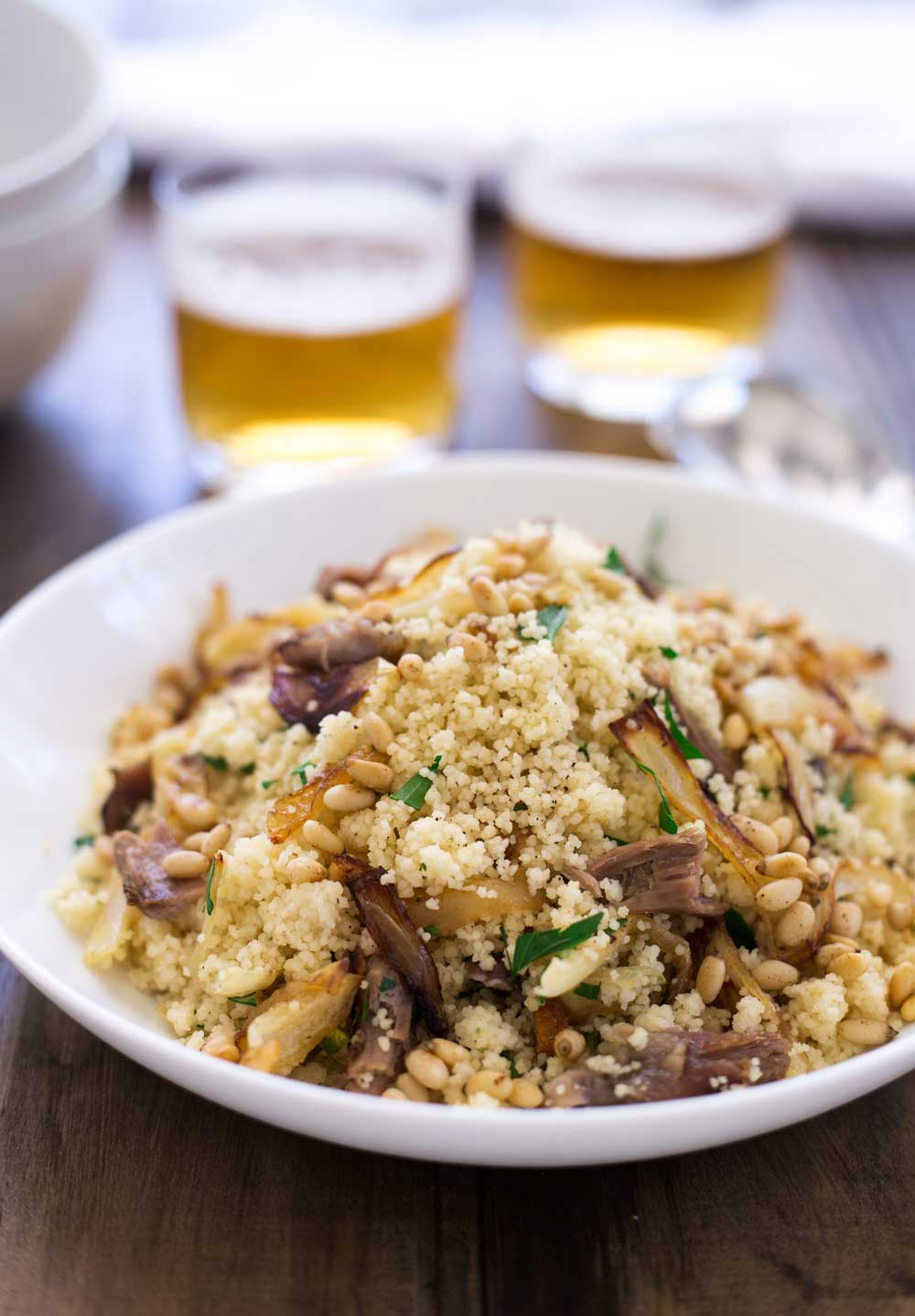 Warm lamb, sweet sticky onions, crunchy buttery pine nuts and fresh parsley all stirred through soft fluffy couscous. This meal is comforting but in no way boring! Eaten by the spoonful with a cold beer it is the perfect easy to eat dinner. Sit down on the sofa, find something good to watch and spoon it into your mouth. Yum! | Sprinkles and Sprouts