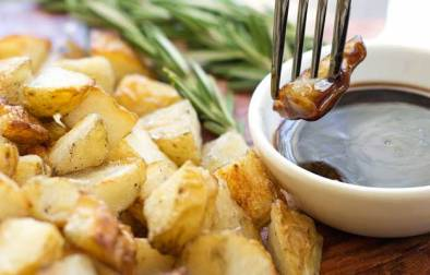 Salt and Vinegar Potato Cubes with Rosemary Balsamic Dip. These potatoes are a mix between a bag chips from the chippy and the Sunday roast potato. They are lightly crispy with a wonderful tang of salt and vinegar.