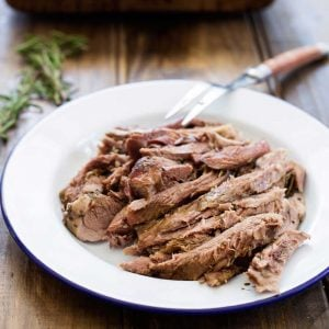 Slow Roasted Lamb with Anchovy and Rosemary. There is a touch of the Greek about this melt-in-the-mouth lamb dish. Succulent, juicy lamb with a rich flavour and a wonderful depth from the rosemary, anchovy and garlic. | Sprinkles and Sprouts