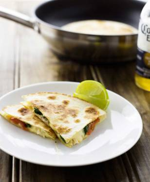 Cajun Chicken Quesadillas. Cheesy spicy chicken filled tortillas grilled until crisp and melted. A delicious snack or light meal.