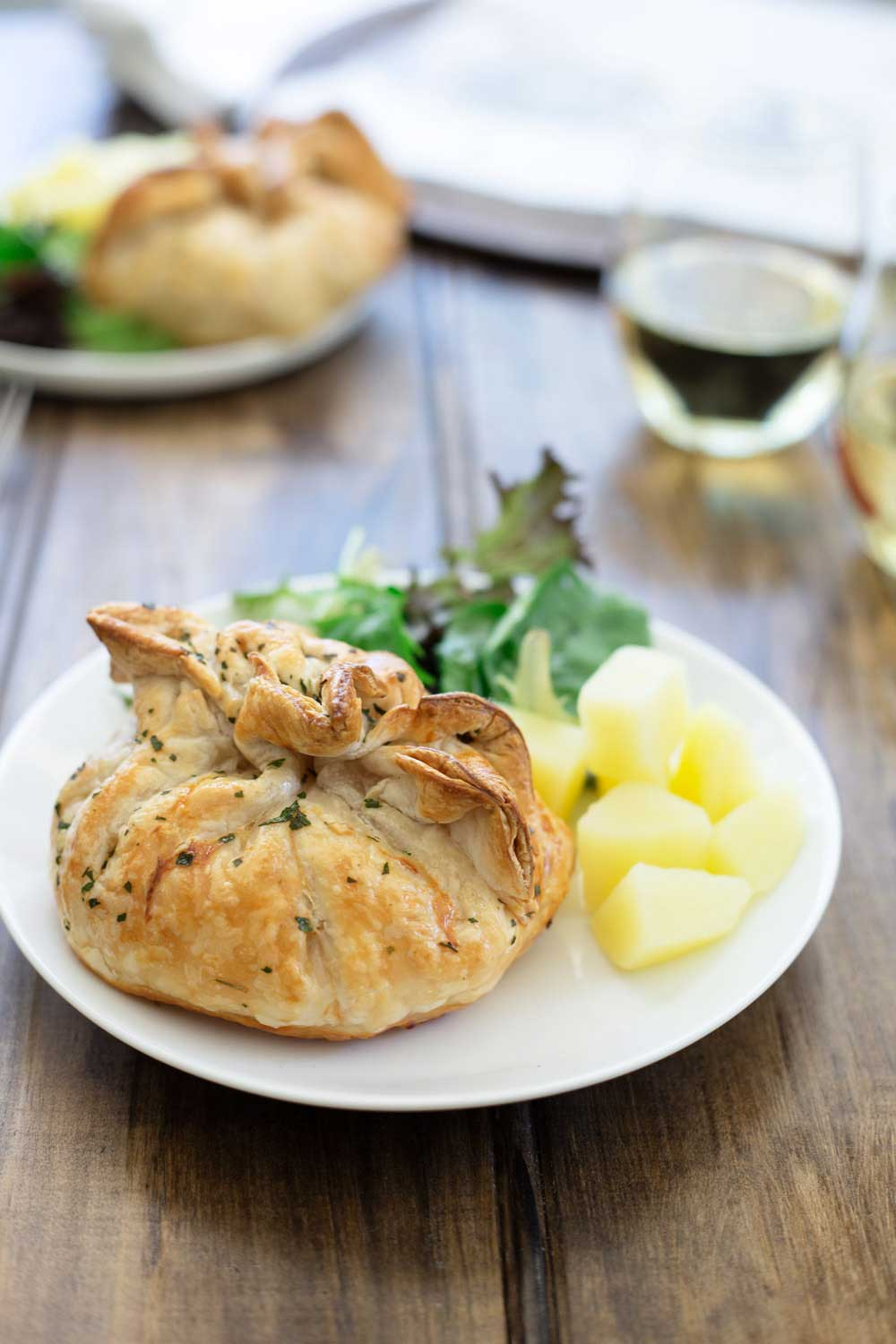 These Garlic Chicken Parcels are super easy and super impressive. Individual parcels, filled with juicy chicken and oozing with garlic butter. They are perfect for entertaining as they can be prepared ahead of time and then just popped in the oven to cook when you sit down for appetisers.