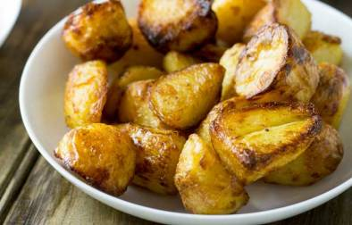 Crispy fluffy roast potatoes that you can prepare a week before Christmas! That is a winner in my book!!! No peeling potatoes on Christmas morning means more time to sip bucks fizz and enjoy watching people open presents.