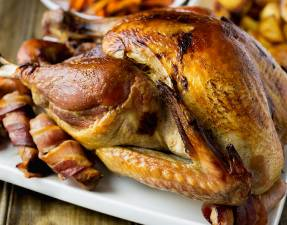 This slow roasted turkey is juicy and so simple. Without any basting, brining or intricate butter rubbing bacon weaving, you get a moist delicious bird.