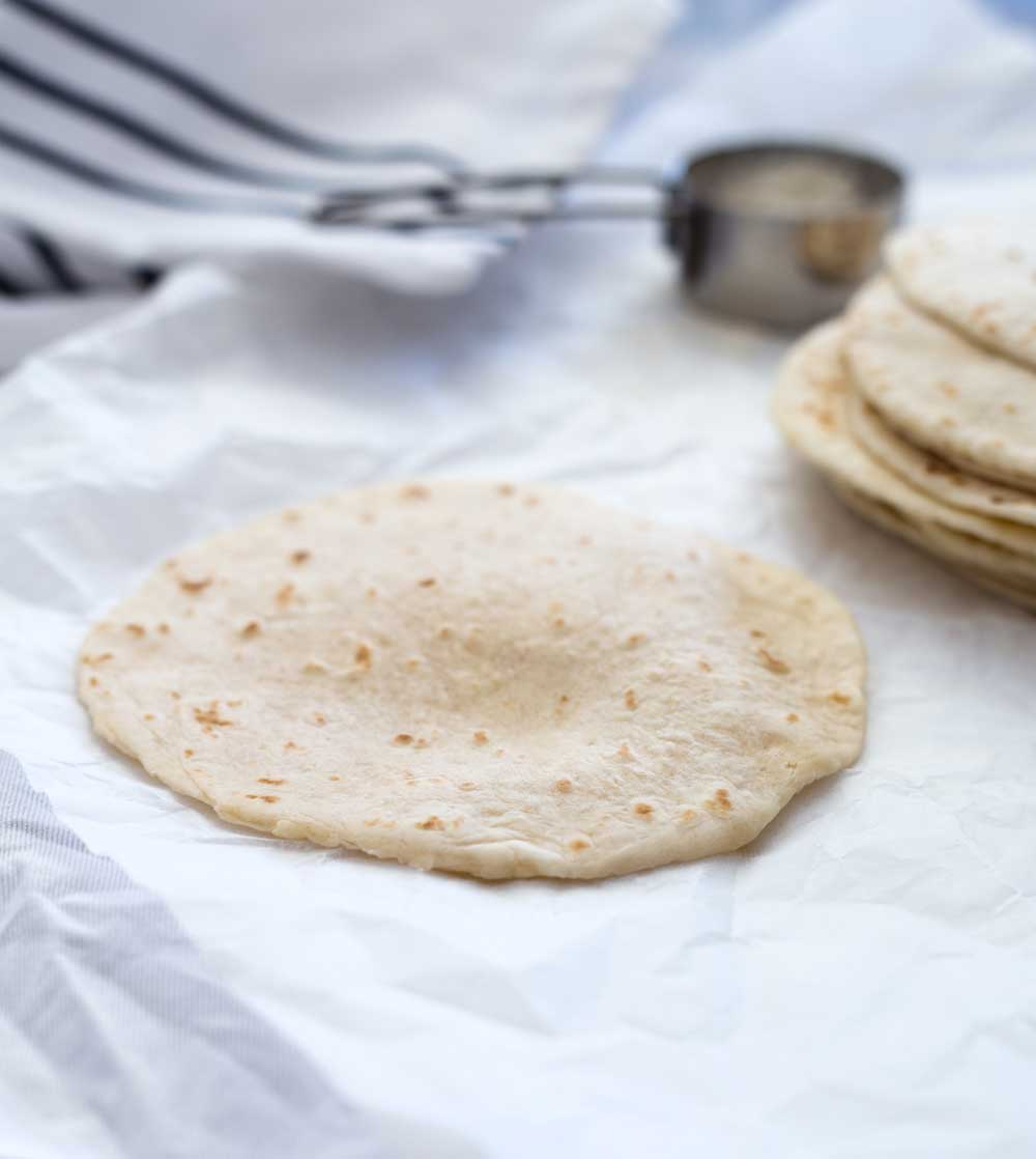 Soft flour tortillas, essential for tacos, quesadillas, burritos and fajitas. This recipe produces soft flexible tortillas with just 5 ingredients.