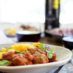 Soft, light, juicy baked Italian meatballs, baked in a rich tomato sauce and served with soft cheesy polenta. This is comfort food at it's very best. The meatballs are so tender and packed full of flavour!