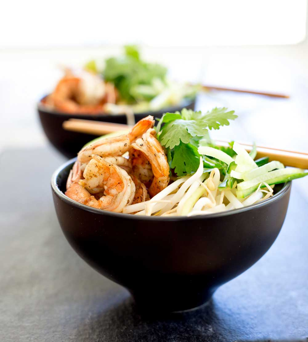 Spiced prawns, a rich spicy coconut broth, ramen noodles, fresh beansprouts and shredded cucumber. Grab some bowls, fill them and slurp up this delicious soup. The slurping is mandatory as it makes it taste better!