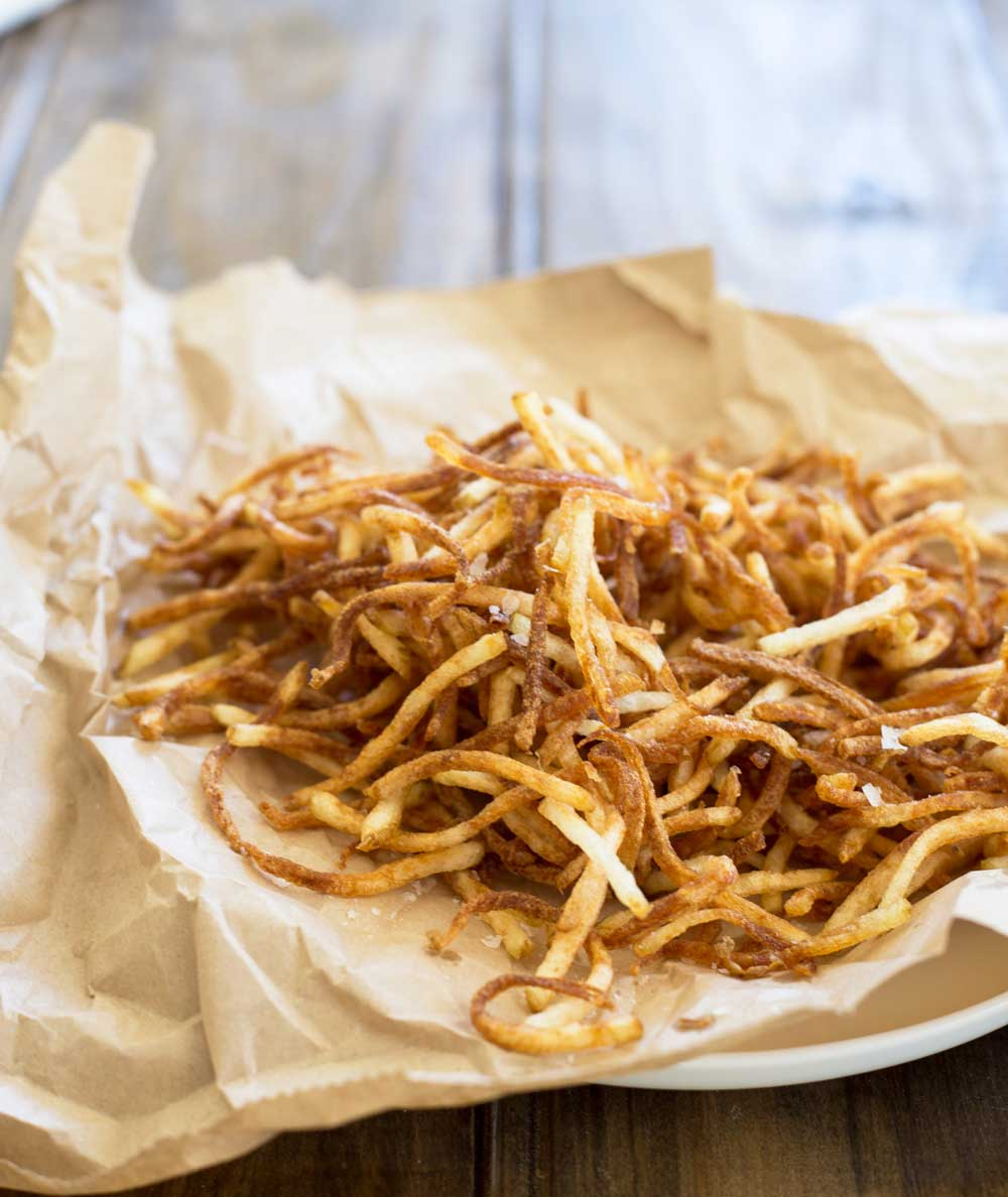 Crispy thin fries that are perfect for a snack or with a meal. Shoestring fries or as you often see these on menus as matchstick fries are darn delicious!