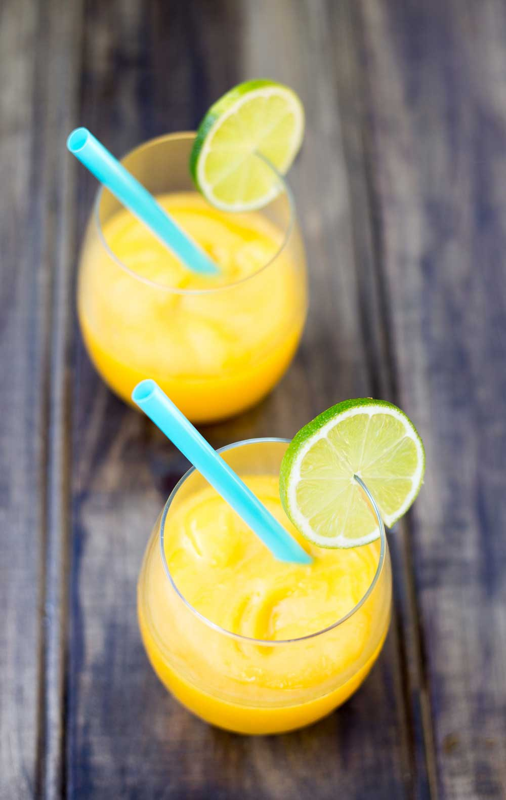 Juicy mango, a hint of lime and a shot of vodka. Simple, cooling and delicious.....also known as Slush puppies or Slurpees for adults :-)