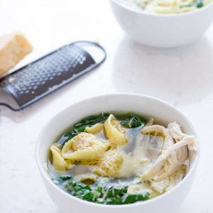 A filling chicken tortellini soup that is as easy to make as heating up a can of soup. But sooooo much better! Take a 2 minute dash around the supermarket and you can have dinner on the table in 10 minutes.