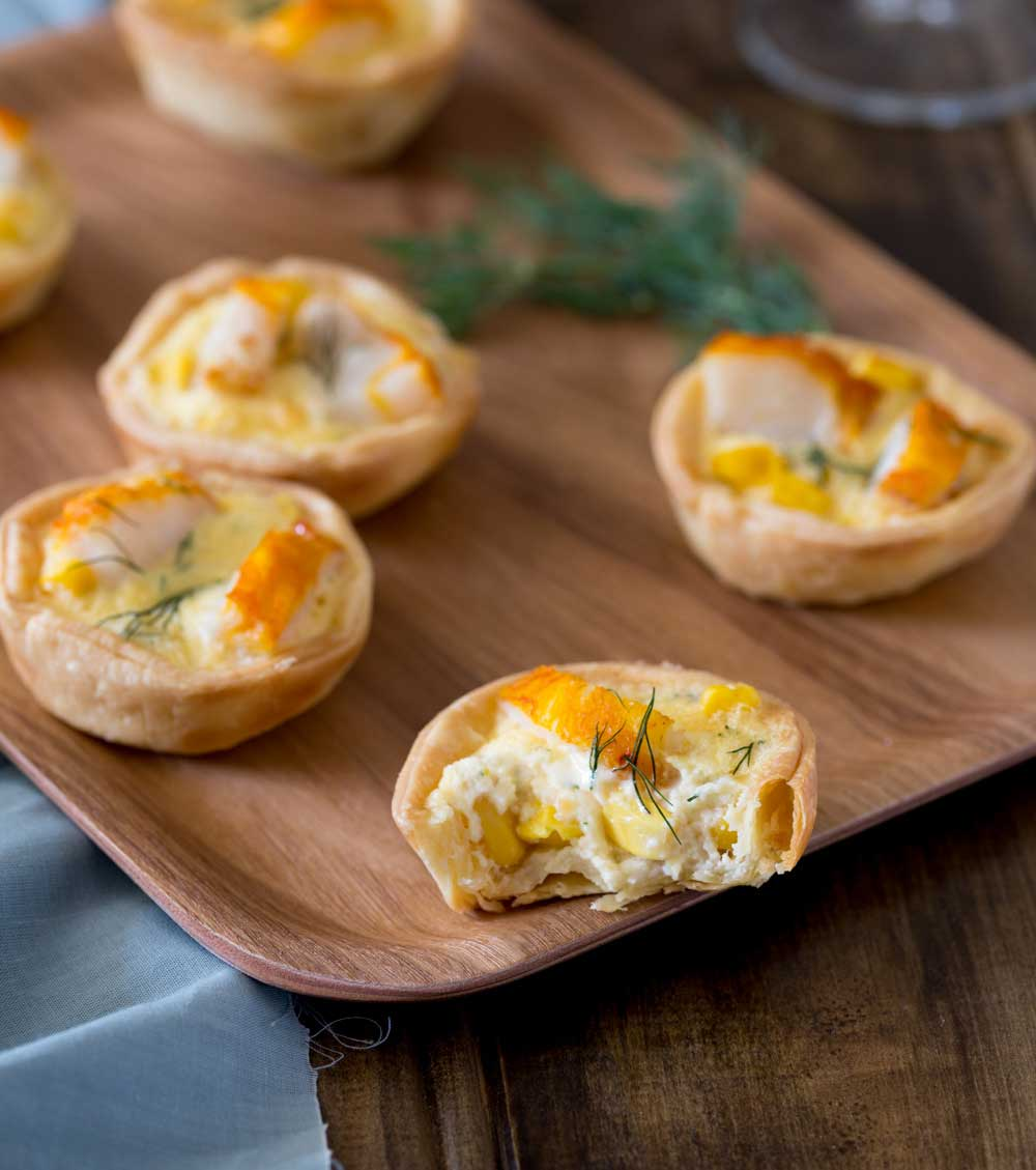 Smoked fish and sweetcorn combined with a a rich egg mixture and incased in a perfectly crisp tartlet case. These Smoked Fish and Sweetcorn Tartlets are so good, I bet you can't stop at one!