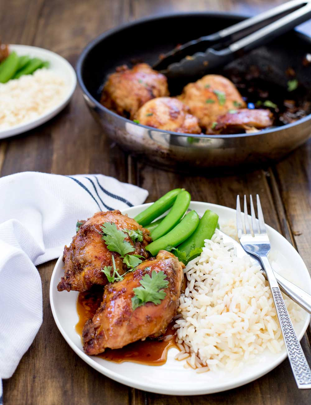 Sweet, spicy chicken with the hint of coconut and the simplicity of cooking it all in one pan on the hob. This is a delicious dinner, perfect for all the family. And it looks beautiful so you can happily serve it to guests.