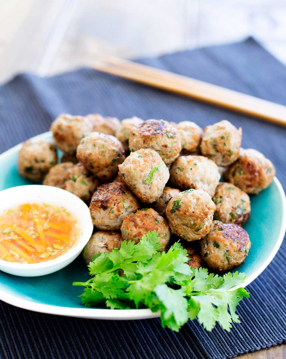 These Thai Pork Meatballs are flavour bombs! Fabulous thai flavours in easy to eat form! Serve these as a canapé, nibble or appetiser. Or cook them up as part of a Thai banquet. However you make them, make sure you grab a few for yourself as these go quickly.