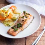 Flaky baked salmon in a lemon butter and caper sauce, served with a refreshing zucchini and carrot salad topped with a tangy orange vinaigrette.
