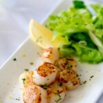 Firm buttery scallops, seasoned with lemon served with a fresh and crunchy apple and parsley salad with shallot dressing.   Sprinkles and Sprouts