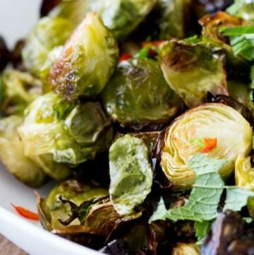 These roasted brussels sprouts are a revelation!!! Deliciously charred, with a fabulously sweet, sour, spicy and salty dressing. I can guarantee that these will be demolished!!!