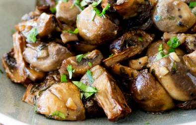 Delicious earthy mushrooms heavy with garlic and thyme. Roasted to golden perfection. This is a wonderful side dish. Perfect for serving with a steak or roast chicken. Or for just stirring through pasta | Sprinkles and Sprouts