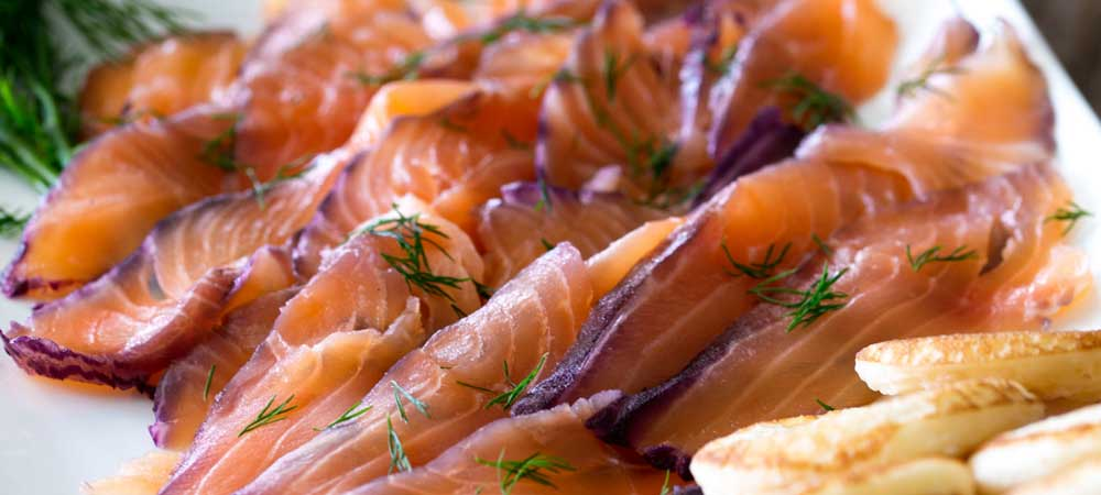 Home cured salmon. A delicious twist on a traditional gravlax. Fruity blueberries, spicy notes of dill and a salty sweet edge. This cured salmon is beautiful and delicious.