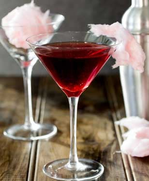 Fairy Floss Martini. A delicious cocktail that adds a bit of theatre to your night! This has a mixture of tart fruit and sweet sugar. Making it a delicious twist on your normal cocktail, plus it is fun. A bit of bar theatre without the need to throw bottles in the air!!!