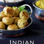 A metal dish piled high with golden indian chicken meatballs, Pinterest image with text at the bottom.
