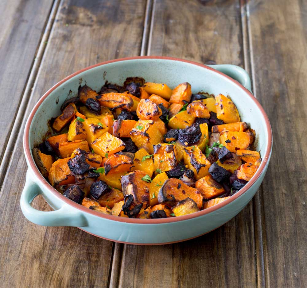 Roasted root veg. Sweet, soft, slightly caramelised and packed full of warming, rich delicious flavours. This is the perfect side or base for a great vegetarian main course. And it is simple to make with whatever you have in your fridge!