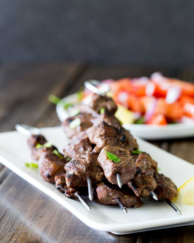 Tender juicy steak, marinated in herbs and spices and then grilled to a crusty perfection. These Brazilian Beef Kebabs are a great mid-week meal. The beef is packed with flavour and with a couple of super simple sides you have a great meal with really very little effort!