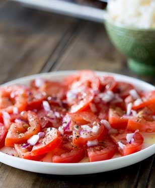A super simple tomato salad with a punch of flavour. Perfect as a side dish with some Brazilian Barbecue | Sprinkles and Sprouts
