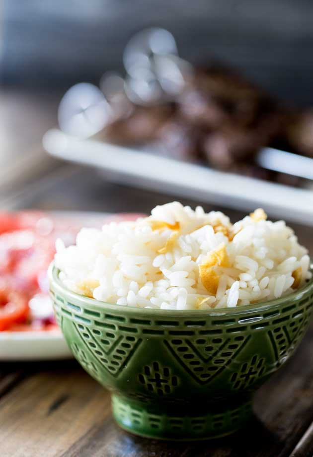 Brazilian White Rice is the perfect side dish, it is generously seasoned with onions and garlic. Turning a bowl of plain rice into something so so much more. | Sprinkles and Sprouts