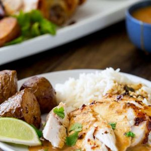 Sweet, juicy chicken with the wonderful flavour of Thai massaman curry, served with some delicious roasted potatoes, plain rice and a rich Thai gravy. This is roast dinner with a booster pack on! | Sprinkles and Sprouts