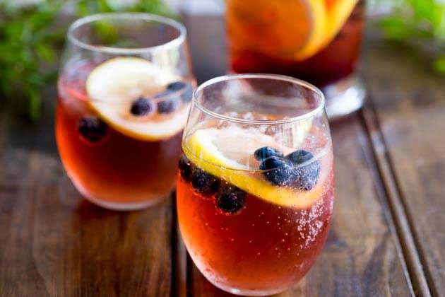 This Lemon and Blueberry Punch, is fruity and refreshing, but it delivers a great kick. Perfect for relaxing with friends, or for serving at a larger party!