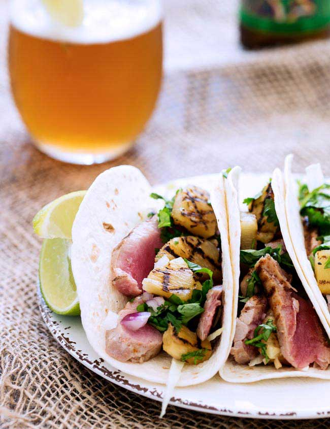 These Tuna and Chargrilled Pineapple Tacos are amazing! Slightly spiced tuna is seared and then stuffed into flour tortillas with a sweet and sour Chargrilled Pineapple Salsa. www.sprinklesandsprouts.com.au